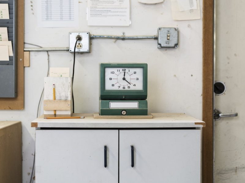 Timeclock used to check in employees in a woodworking factory.